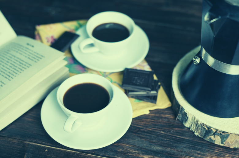 2 cups of coffee, chocolate and a book
